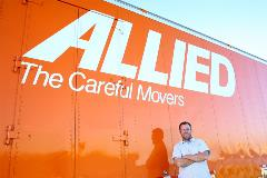 Allied van lines worker in front of a truck
