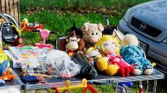 childhood stuffed animals at a garage sale