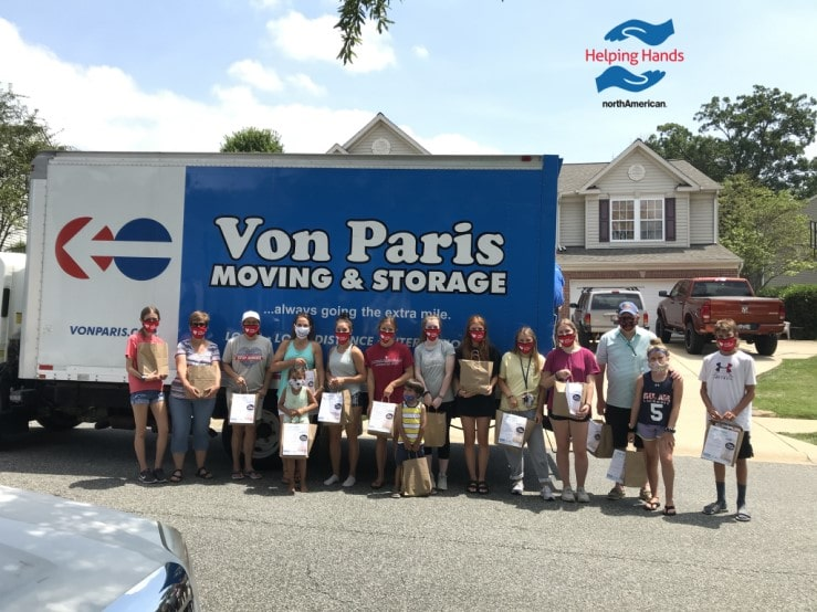 IMG_3888 von paris front porch food drive july 2020 volunteers by truck HH blog featured-min