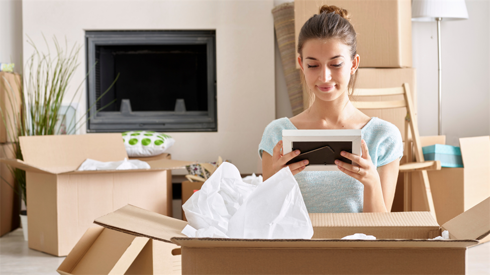 Woman unpacking boxes in home